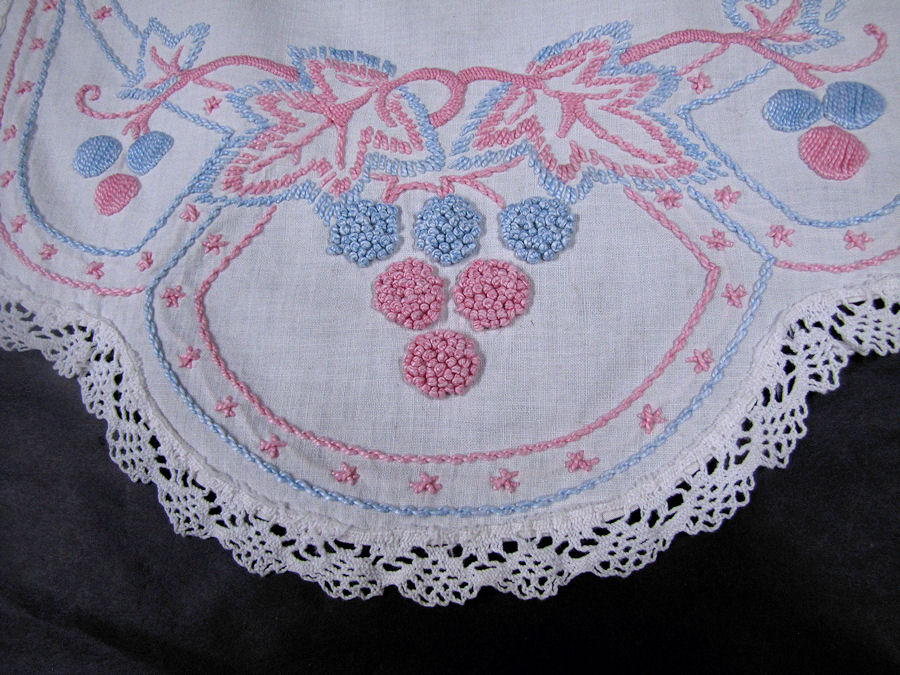 close up vintage antique table runner handmade French knots