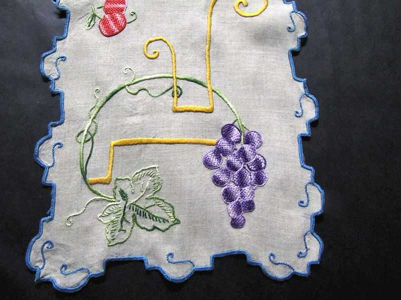 close up antique table runner handmade arts and crafts