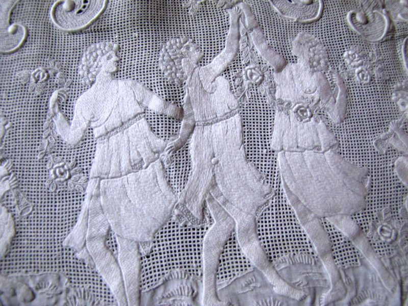 close up vintage antique table runner handmade figural appenzell lace