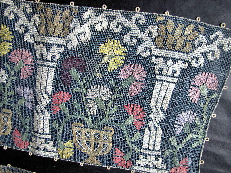 close up vintage antique table runner handmade figural lace