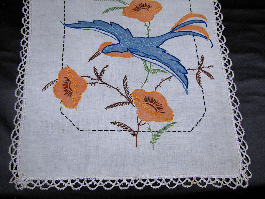 close up vintage antique table runner handmade arts and crafts bluebird