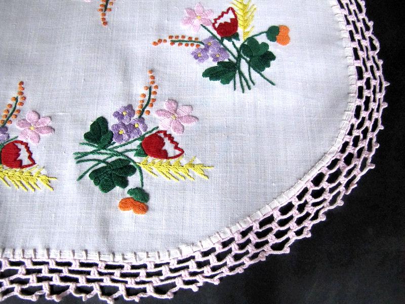 close up vintage antique table topper vivid flowers